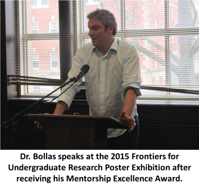 Photo of Dr. Bollas speaking at 2015 Frontiers for Undergraduate Research Poster Exhibition after receiving his Mentorship Excellence Award