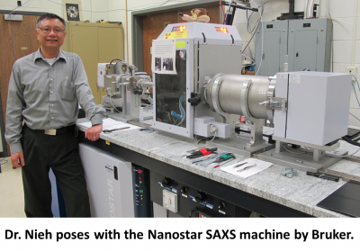 Photo of Dr. Nieh posing with the Nanostar SAXS machine by Bruker