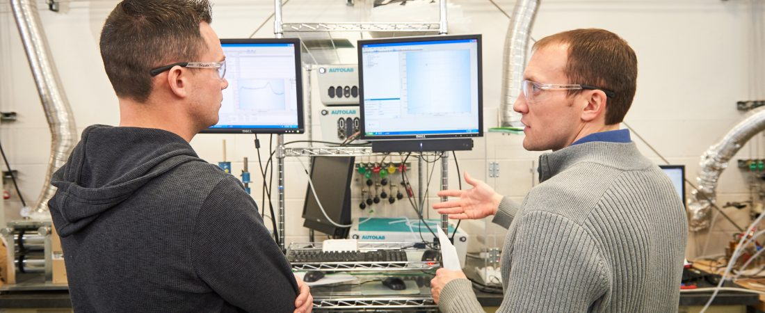 William Mustain, associate professor of chemical and biomolecular engineering, and Travis Omasta, a Ph.D. student in chemical engineering in a lab at C2E2 on Jan. 21, 2016. (Peter Morenus/UConn Photo)